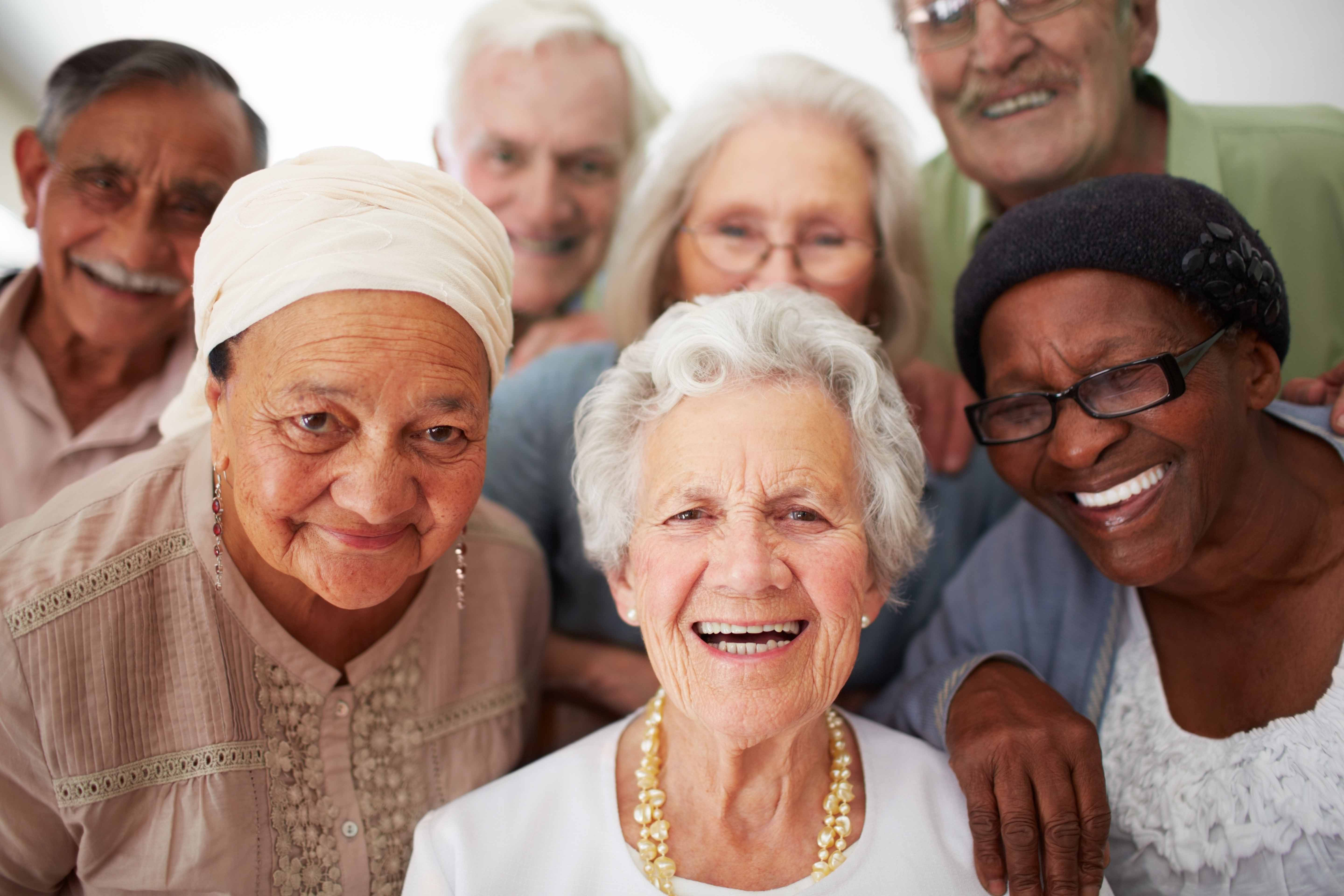 group of multi-ethnic seniors smiling