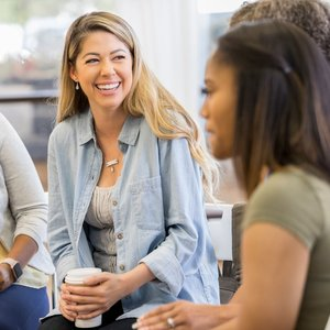 Smiling woman at group therapy session