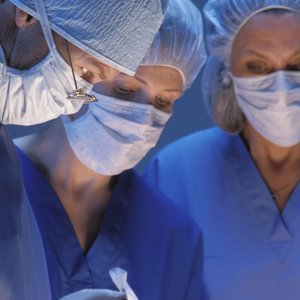 Two nurses and a doctor in the operating room