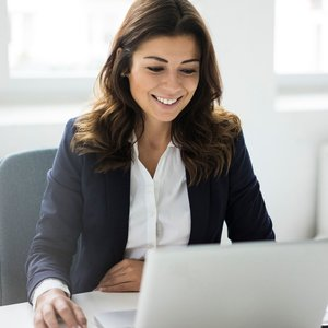 woman in blazer with laptop