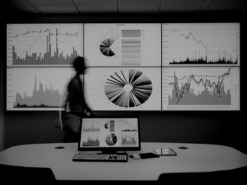 A man in front of a large screen with data and charts on it.
