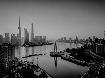 Shanghai Pudong sunrise over a city and river.