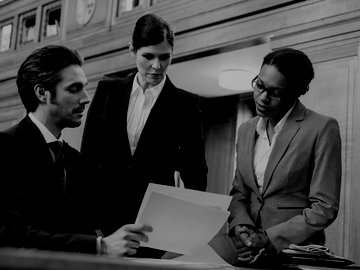 three lawyers reviewing legal documents