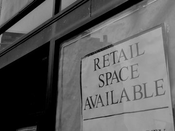 Storefront with a sign that says Retail Space Available