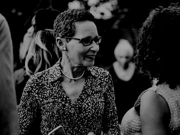 Smiling woman in discussion with another woman