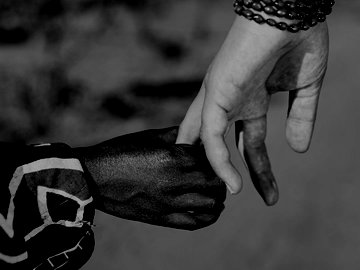 Black and white holding hands